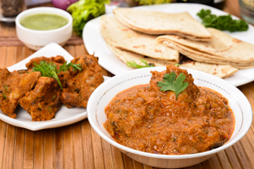 Rajasthani red chicken curry with baked chapatis %284%29  teekha murgh tikka %284%29 with chutney